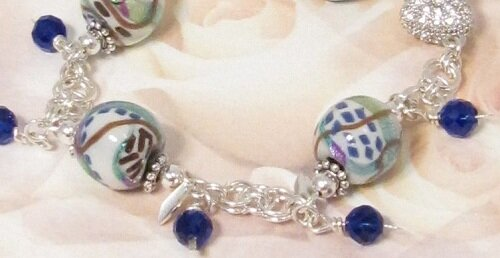 Chain mail bracelet with polymer clay and crystal beads